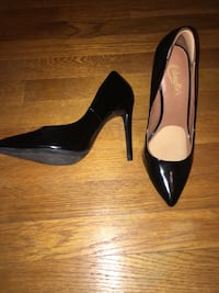 Pair of black leather pointed-toe heels with sole pads