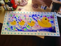 four ducklings with multicolored background painting