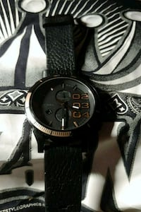 Diesel black and gold watch / leather band  Tucson, 85719