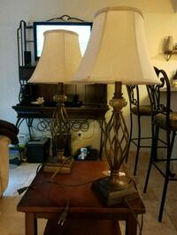 Two bronze steel lamps with shades and bulbs