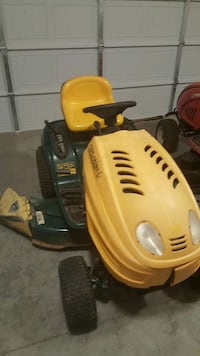 yellow and green ride on lawn mower