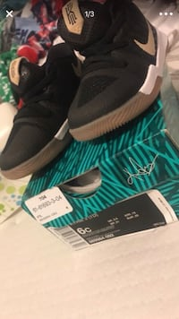 pair of black Adidas NMD shoes New York, 10018