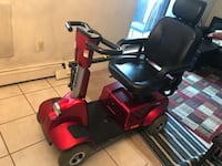 red and black mobility scooter