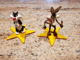 Wile E. Coyote and Sylvester Standing on Yellow Stars.