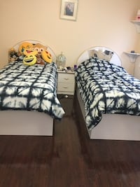 Two white twin beds
