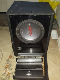 black Alpine loaded subwoofer enclosure and power