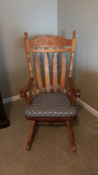 brown wooden frame padded rocking chair