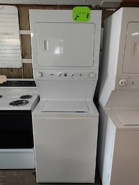 white stacked washer and dryer set