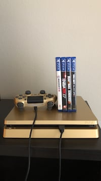 Gold PS4, controller, and four games