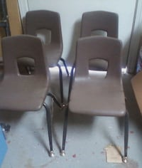 two gray leather padded armchairs Hughson