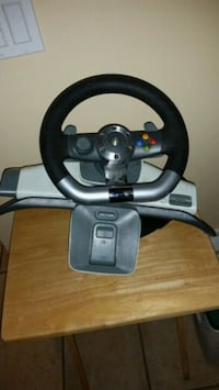 black and gray steering wheel game controller West Kelowna, V4T 2M9