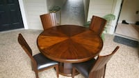 round brown wooden table with four chairs dining set Houston, 77063