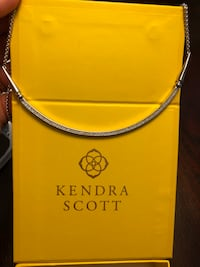 silver-colored Kendra Scott necklace