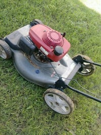 red and black push mower Lubbock, 79411