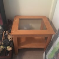 "Wooden end table with glass centre. Measures 25"" x 28"" and 23"" tall.  Acton, L7J 3A1"