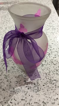 pink frosted glass vase with bow accent