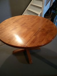 Solid Wood, Round Table with Collapsible Sides.