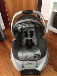 baby's gray Graco portable car seat carrier