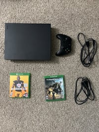 XboxOneX 1TB(Brand new like condition)with2games.Nrly 6monswarnty left