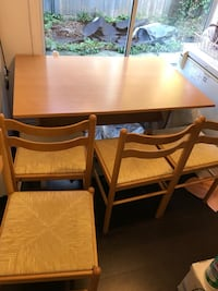 Rectangular brown wooden table with four chairs dining set Surrey, V3R 5G1
