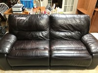 Dark brown leather dual reclining couch. Small tear in the back of the couch. PRICE NEGOTIABLE  Alexandria, 22309