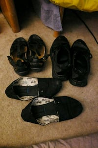 three pairs of black and gray shoes Clifton, 20124