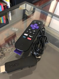 black Roku TV box with remote
