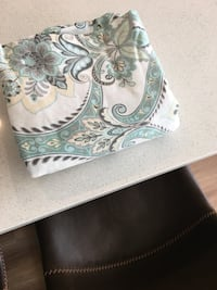 white and teal floral textile Canmore