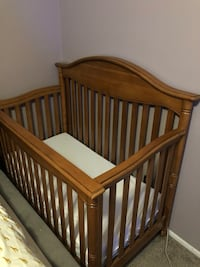 Baby's brown wooden crib Tampa, 33624