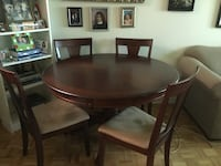 round brown wooden table with four chairs dining set Mississauga, L5B 4B2
