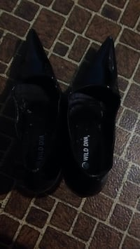 pair of black leather shoes Calgary, T1Y 3A9