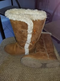 pair of brown suede fur-lined duffel knee-high boots