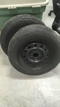 black bullet hole car wheel with tire
