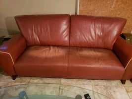 red leather sofa and chair and ottoman