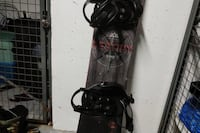 black and red snowboard with bindings 536 km