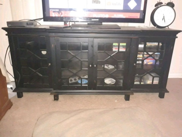 Beautiful glass fronted entertainment center