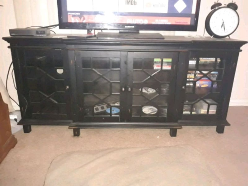 Beautiful glass fronted entertainment center  0926010c-0e01-4651-9031-be36088522a5