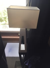 2 white lamps . One needs to be super glued .  Edmonton, T5X