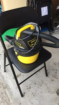 black and yellow wet and dry vacuum cleaner