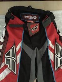 black, red, and white hockey pants