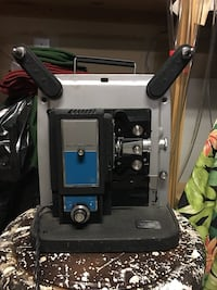 Projector by  Keystone with screen, lamp and film  2284 mi