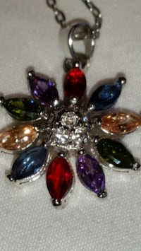 REAL CRISTAL PENDANT BEAUTIFUL COLOURS ON A SILVER TONE CHAIN