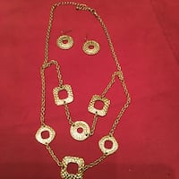 Gold-colored necklace and earrings. Melbourne, 32940
