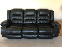 Leather reclining sofa and matching recliner.  Like new