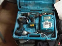 blue and black Makita corded power tool with case 3688 km