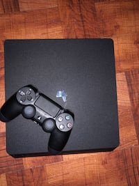 black Sony PS4 console with controller Washington, 20024