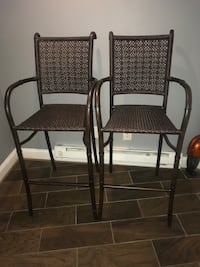 Two black steel frame brown wicker armchairs Washington, 20010
