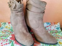 pair of gray suede boots