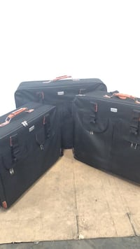 black and gray travel luggage 1218 mi