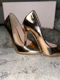 Gold Metallic Stiletto Pumps by JustFab. Like new